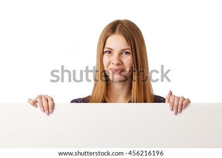 Smiling young girl with blank white board over white background.