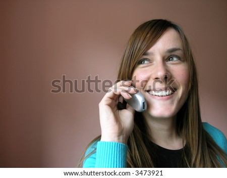 Smiling young girl with cellular phone.
