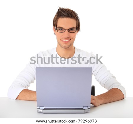 Smiling young guy using notebook computer. All on white background. - stock photo
