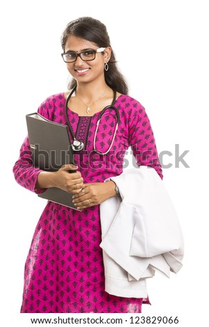 smiling young Indian Female Doctor posing with document on white. - stock photo