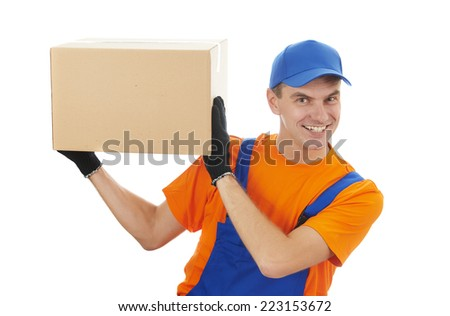Smiling young male postal delivery courier man delivering package cardboard box - stock photo