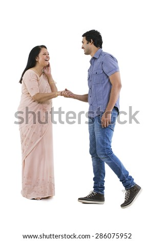 Smiling young man approaching his mother to dance
