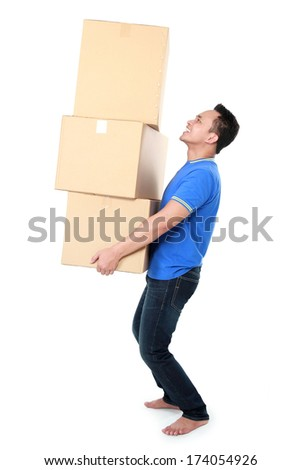 Smiling young man holding cardboard box isolated on white background. moving day concept