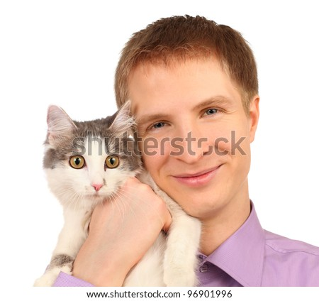 Smiling young man holds surprised cat isolated on white background - stock photo