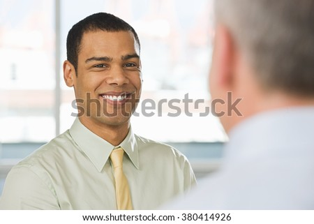 Smiling young man in an interview - stock photo