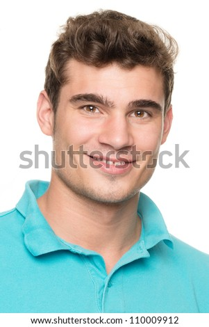 Smiling young man in front of white background - stock photo