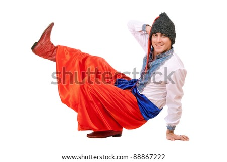 Smiling young man in the Ukrainian national costume - stock photo