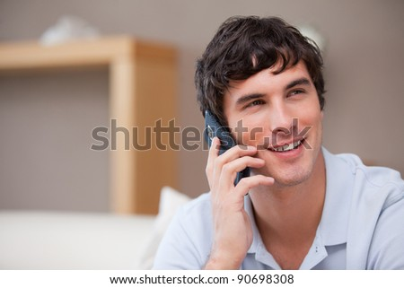 Smiling young man on the phone - stock photo