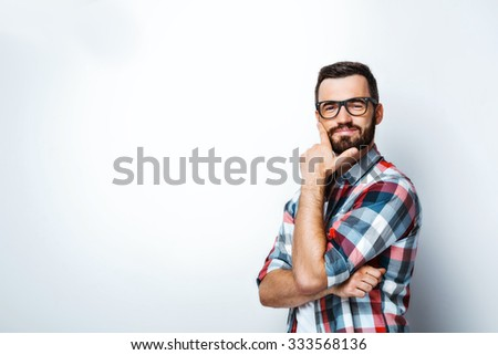 Smiling young man on white background. Stylish man wearing glasses, looking at camera and smiling - stock photo
