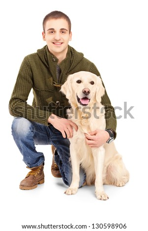 Smiling young man posing with a retriever dog isolated on white background - stock photo