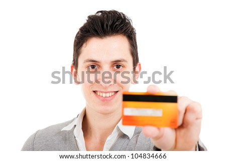 smiling young man showing credit card, isolated on white background.