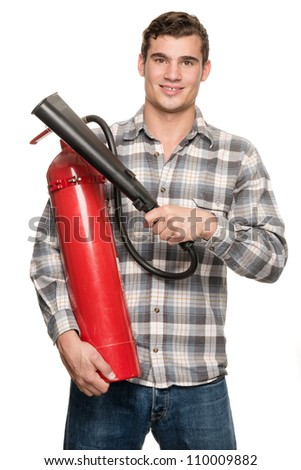 Smiling young man with extinguisher in front of white background - stock photo