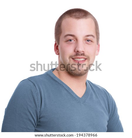 smiling young man with goatee beard - stock photo