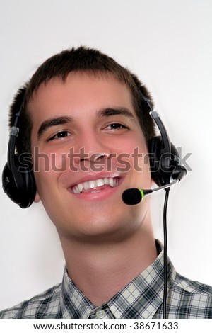 smiling young man with head set - stock photo