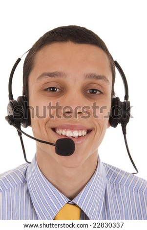 Smiling young man with telephone headset isolated on white - stock photo