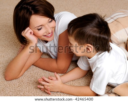 Smiling young mother has a good time in conversations with the son of preschool age