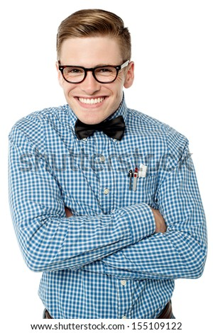 Smiling young nerd posing with crossed arms - stock photo