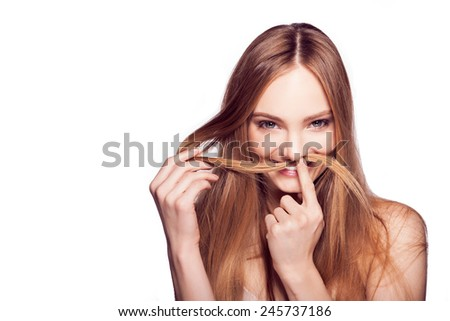 Smiling Young Pretty blond Beautiful girl with hair mustache. Hands at the person - stock photo