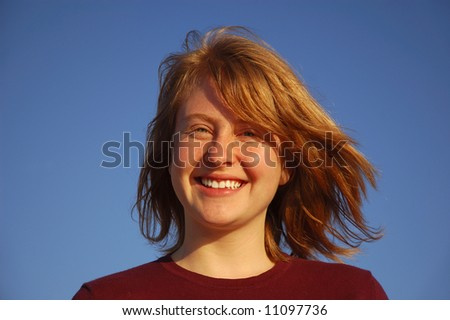 Smiling young redheaded woman - stock photo