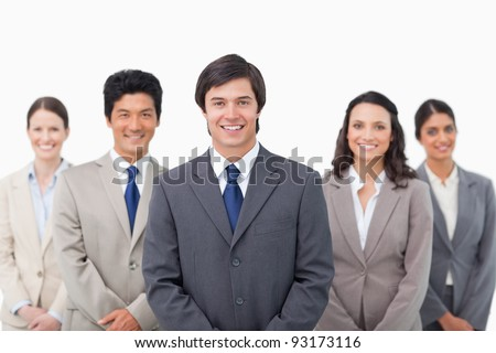 Smiling young salesteam standing against a white background
