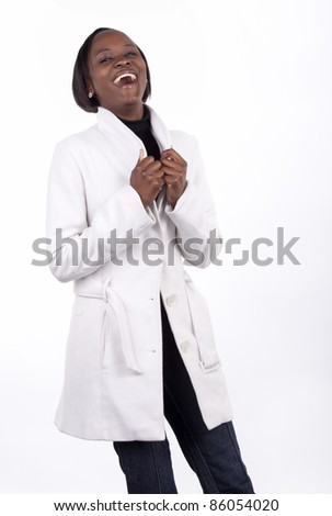Smiling young South African woman on a white background with winter's clothes. - stock photo