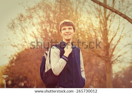 Smiling young student relaxing in a city park.Relaxing,Outdoors.Park. - stock photo