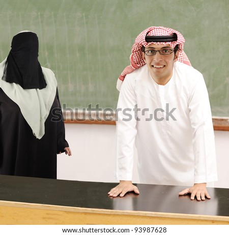 Smiling young success man, arabic traditional clothes, education and fashion concept, indoor, school or university, student or teacher. - stock photo
