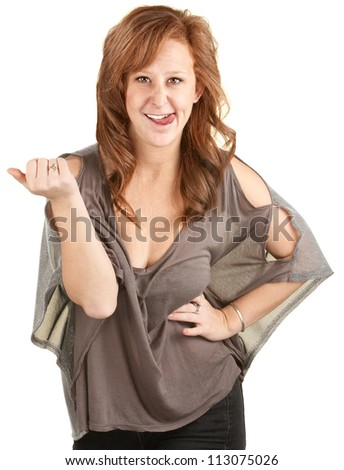 Smiling young woman biting tongue over white background - stock photo