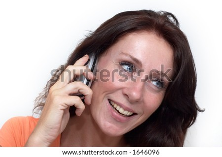 smiling young woman calling by phone - stock photo