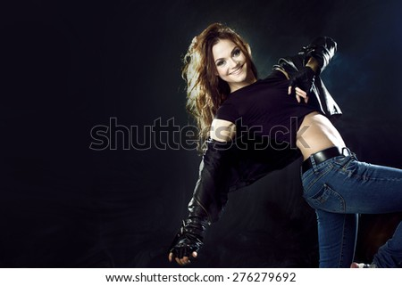 smiling young woman dancing, hair flying - stock photo