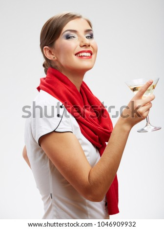 Smiling young woman drinking alcohol cocktail. isolated studio portrait.