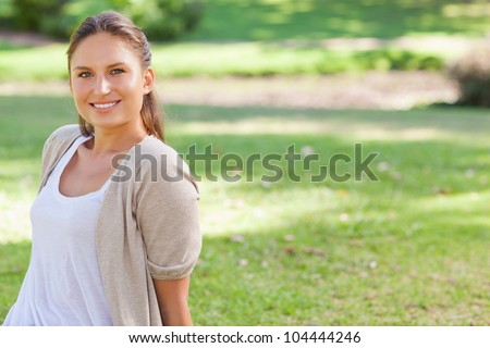 Smiling young woman enjoying her time in the park