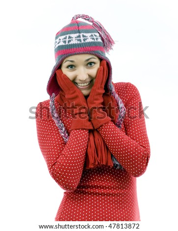 smiling young woman from face in palms in winter cap - stock photo