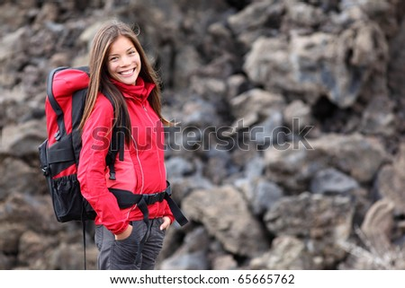 Smiling young woman hiker hiking outdoors. Portrait of mixed race Asian / Caucasian model. Photo from Teide, tenerife. - stock photo