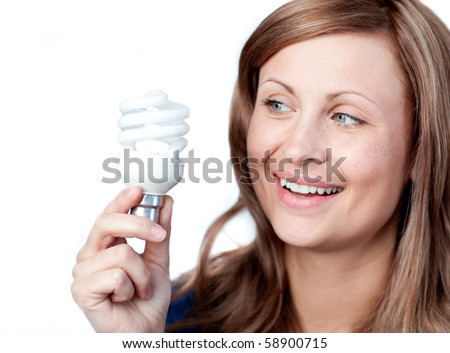 Smiling young woman holding a light bulb against white background - stock photo