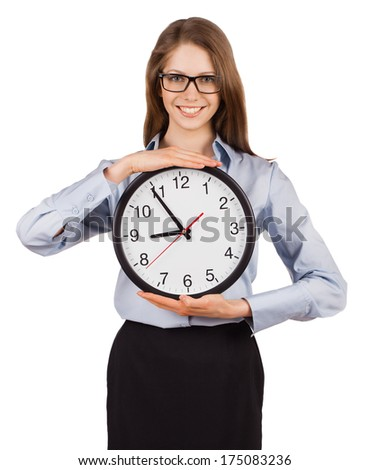 Smiling young woman holding a round clock