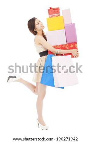 smiling young woman holding gift box and shopping bag - stock photo
