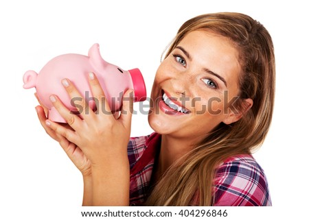 Smiling young woman holding piggybank  - stock photo