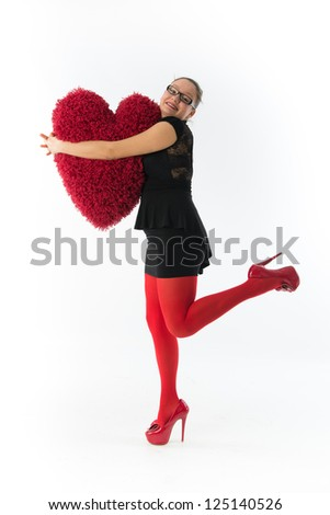 smiling young woman holds a large hairy red heart - stock photo