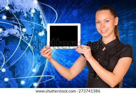 Smiling young woman holging blank tablet with black screen and looking at camera on earth model background. Connection all over the world. Elements of this image furnished by NASA - stock photo