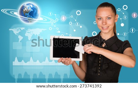 Smiling young woman holging tablet and blank card with 3d Earth model with graphical charts and looking at camera on abstract blue background. Elements of this image furnished by NASA