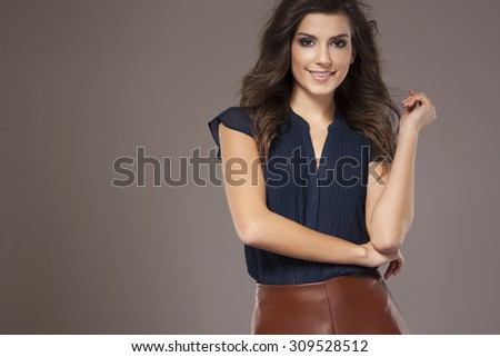Smiling young woman in stylish clothes