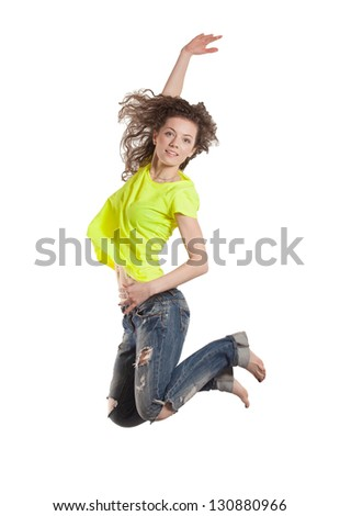 smiling young woman jumping with her hand up - stock photo