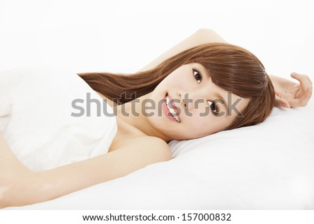 smiling young woman lying on the bed