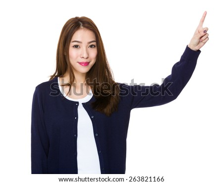 Smiling young woman pointing upwards  - stock photo