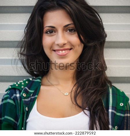 Smiling young woman portrait outdoors. - stock photo