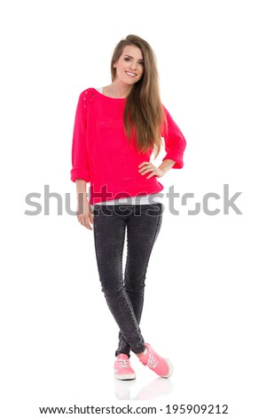 Smiling young woman posing. Smiling young woman posing. Full length studio shot isolated on white. - stock photo