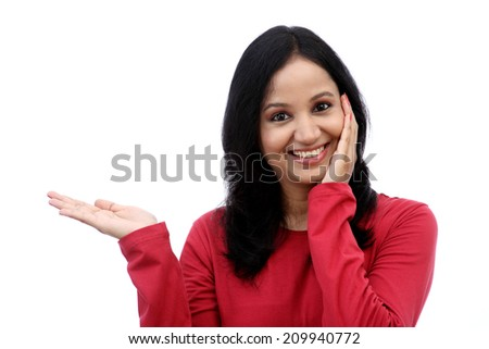 Smiling young woman showing isolated presentation against white - stock photo