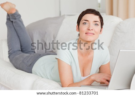 Smiling young woman with a laptop