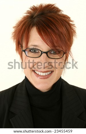 Smiling young woman with bright red hair wearing black rimmed eye glasses.